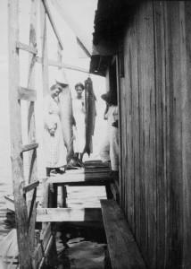 Eva Henderson, Nellie Baker, Marvin Henderson at stilt camp in Gulf. Photo courtesy of Maranell Baker Fleming.