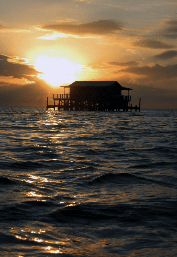 Beautiful West Pasco County sunset behind a historic stilt house. Image courtesy of Pasco Tourism Development.