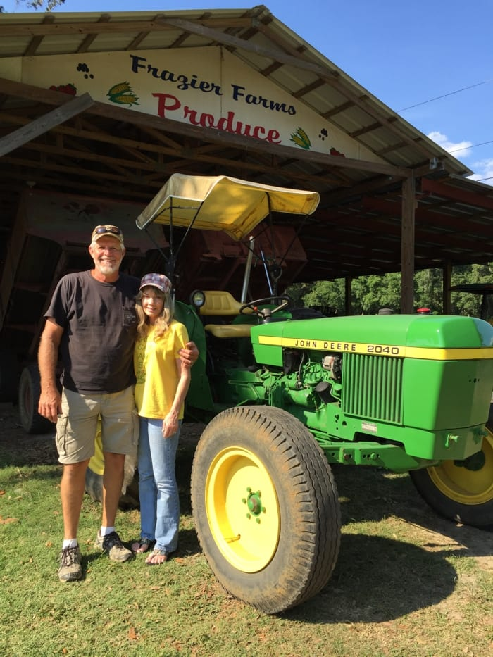David and Sharon Frazier with Walter Frazier's fully restored John Deere tractor.